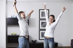 Germany, Bavaria, Young couple playing with game console Stock Photos