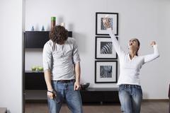 Stock Photo of Germany, Bavaria, Young couple playing with game console