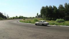 Volvo 122S, Lancia Fulvia Coupe and Volkswagen Beetle on road, click for HD Stock Footage