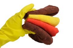 rubber glove and stack of towels - stock photo