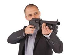 Mafia man is holding a shotgun Stock Photos