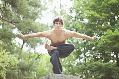 Germany, Bavaria, Young man performing martial arts - stock photo