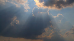 Floating in the sky storm clouds blocking the sun Stock Footage