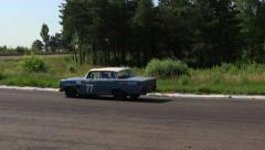 Retro car Mercedes Benz 300SE wide turn on racing track, click for HD Stock Footage