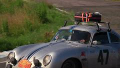 Silver Porsche 356A followed by Mercedes Benz 300 SE, click for HD Stock Footage