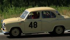 Vintage Morris Oxford one light broken moving slowly, click for HD - stock footage