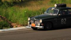 Volvo Amazon with light and wheel on roof on driveway, click for HD - stock footage