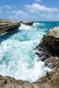 waves crashing on the coastline devil's bridge antigua - stock photo