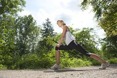Germany, Munich, Mid adult woman exercising - stock photo