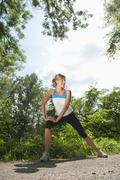 Stock Photo of Germany, Munich, Mid adult woman exercising