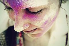 India, Ahmedabad, Young woman celebrating holi festival with powder paint Stock Photos