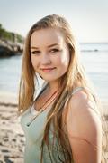 Stock Photo of Spain, Mallorca, Teenage girl on beach, smiling, portrait