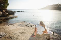 Spain, Mallorca, Couple sitting on beach Stock Photos