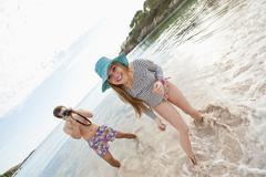 Spain, Mallorca, Couple taking pictures on beach - stock photo