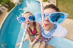 Spain, Mallorca, Couple playing on swimming pool Stock Photos