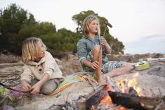 Spain, Mallorca, Children barbecueing sausages on beach Stock Photos