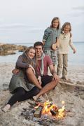 Spain, Mallorca, Friends at camp fire on beach Stock Photos