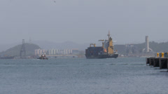 Comercial ship and tugboat  in harbor Stock Footage