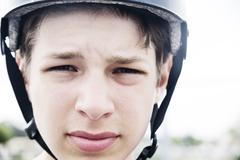 France, Teenage boy with helmet, close up Stock Photos