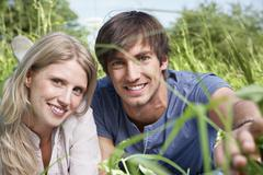 Germany, Cologne, Young couple smiling, potrait - stock photo