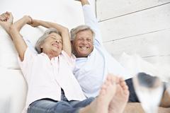 Spain, Senior couple waking up, smiling Stock Photos