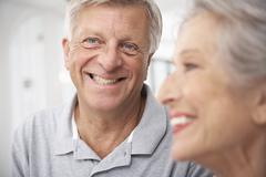 Spain, Senior couple in hotel, smiling - stock photo