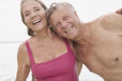 Spain, Senior couple on beach - stock photo
