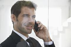 Spain, Businessman talking on mobile phone - stock photo