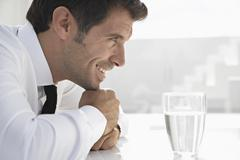 Spain, Businessman thinking, smiling - stock photo