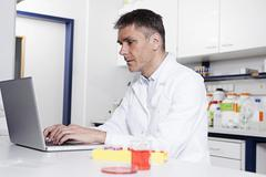 Germany, Bavaria, Munich, Scientist using laptop in laboratory Stock Photos