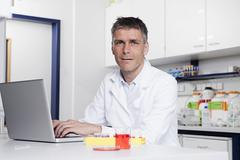Germany, Bavaria, Munich, Scientist with laptop in laboratory, portrait Stock Photos