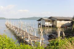 fisherman's house in tropical sea. - stock photo