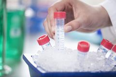 Germany, Bavaria, Munich, Scientist storing test samples in ice Stock Photos