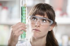 Germany, Bavaria, Munich, Scientist with test tube in laboratory Stock Photos