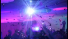 Confetti flying upon night club dance floor. People waving hands, click for HD Stock Footage