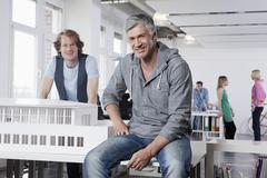 Germany, Bavaria, Munich, Men with architectural model in office, colleagues Stock Photos