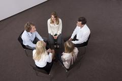 Stock Photo of Germany, Bavaria, Munich, Men and women discussing in office