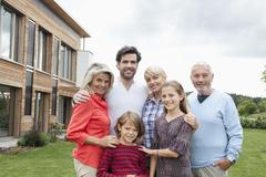 Stock Photo of Germany, Bavaria, Nuremberg, Portrait of family in front of house