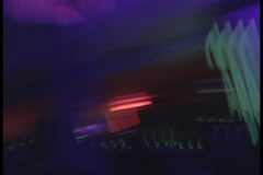 Silhouette of DJ playing. People dance, jump and wave hands., click for HD - stock footage