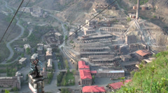 Former Soviet copper mine, and cable car to transport workers - stock footage