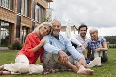 Stock Photo of Germany, Bavaria, Nuremberg, Portrait of family sitting in front of house
