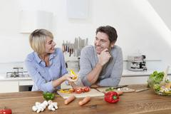 Germany, Bavaria, Munich, Mature couple in kitchen, smiling Stock Photos