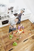 Germany, Bavaria, Munich, Family having fun in kitchen Stock Photos