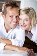 Germany, Mid adult couple smiling, close-up Stock Photos