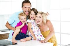 Stock Photo of Germany, Playful family, smiling, portrait