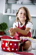 Stock Photo of Germany, Girl playing with spaghetti, smiling, portrait