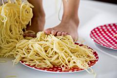 Stock Photo of Germany, Girl standing in spaghetti