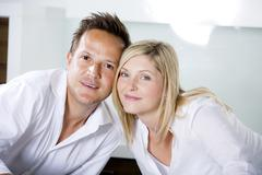 Germany, Mid adult couple standing in kitchen very close, portrait Stock Photos