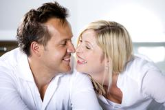 Germany, Mid adult couple touching nose, smiling - stock photo
