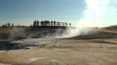Tourists watching fumaroles and mud pools in iceland Stock Footage